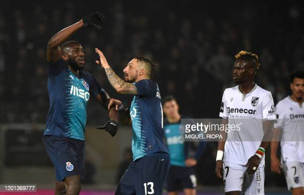 FC Porto's Malian forward Moussa Marega reacts and attempts to leave the pitch after hearing racists chants as FC Porto's Brazilian defender Alex...