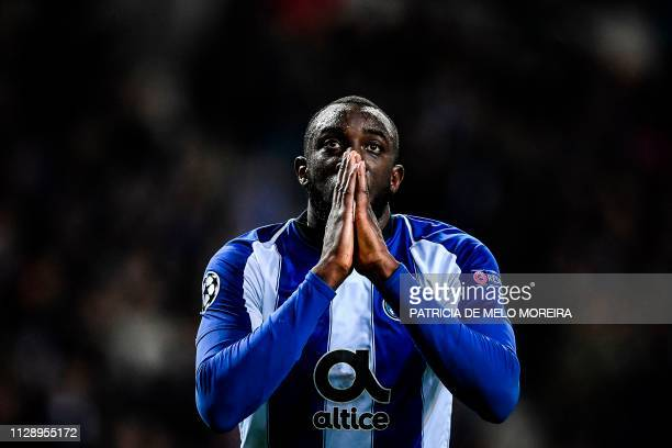 TOPSHOT Porto's Malian forward Moussa Marega reacts to a missed goal opportunity during the UEFA Champions League round of 16 second leg football...
