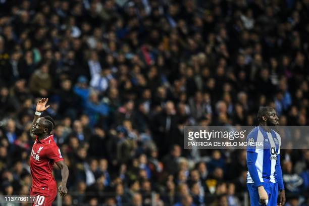 Porto's Malian forward Moussa Marega reacts to Liverpool's Senegalese midfielder Sadio Mane's opener during the UEFA Champions League quarterfinal...