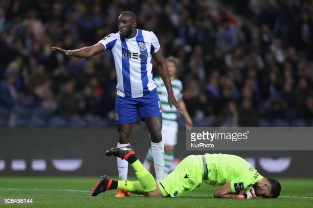 Porto's Malian forward Moussa Marega reacts with Sporting's Portuguese goalkeeper Rui Patricio during the Premier League 2017/18 match between FC...