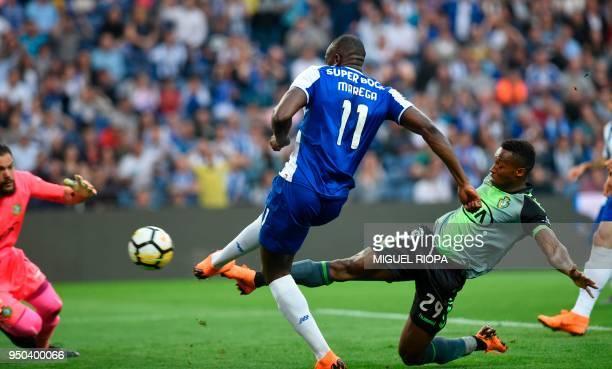 Porto's Malian forward Moussa Marega scores against Vitoria FC's Portuguese midfielder Jose Semedo during the Portuguese league football match...