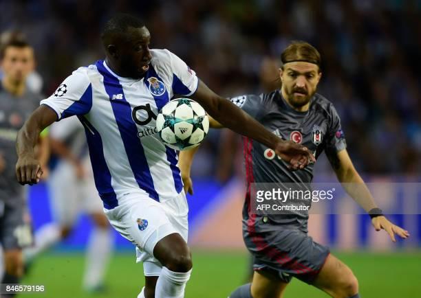 Porto's Malian forward Moussa Marega vies with Besiktas' defender Caner Erkin during the UEFA Champions League football match FC Porto vs Beskitas JK...