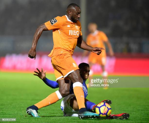 Porto's Malian forward Moussa Marega vies with Feirense's Brazilian defender Flavio Ramos during the Portuguese league football match CD Feirense vs...