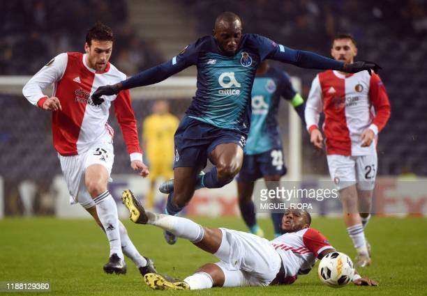 FC Porto's Malian forward Moussa Marega vies with Feyenoord's Brazilian defender Eric Botteghin and Feyenoord's Dutch midfielder Leroy Fer during the...