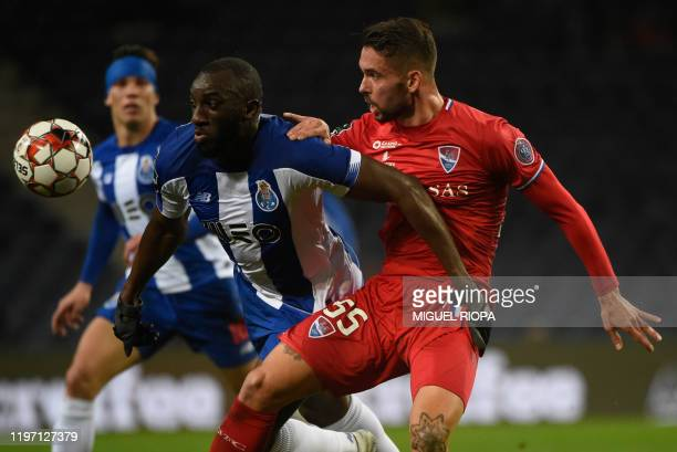 FC Porto's Malian forward Moussa Marega vies with Gil Vicente's Portuguese defender Henrique Gomes during the Portuguese league football match FC...