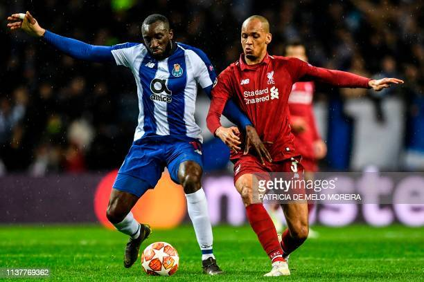 Porto's Malian forward Moussa Marega vies with Liverpool's Brazilian midfielder Fabinho during the UEFA Champions League quarterfinal second leg...