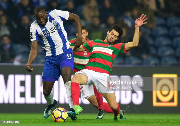 Porto's Malian forward Moussa Marega vies with Maritimo's Portuguese midfielder Fabio Pacheco during the Portuguese league football match FC Porto vs...