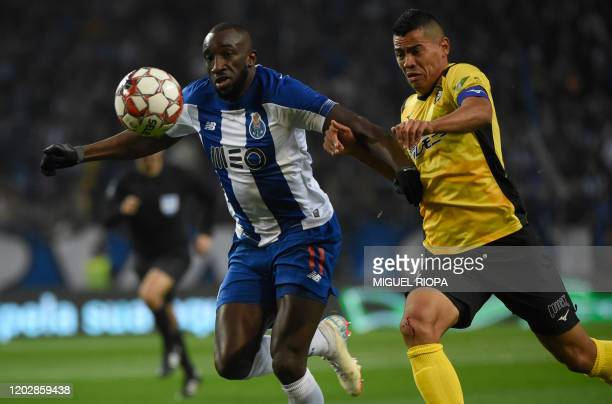 FC Porto's Malian forward Moussa Marega vies with Portimonense's Brazilian defender Jadson during the Portuguese league football match between FC...