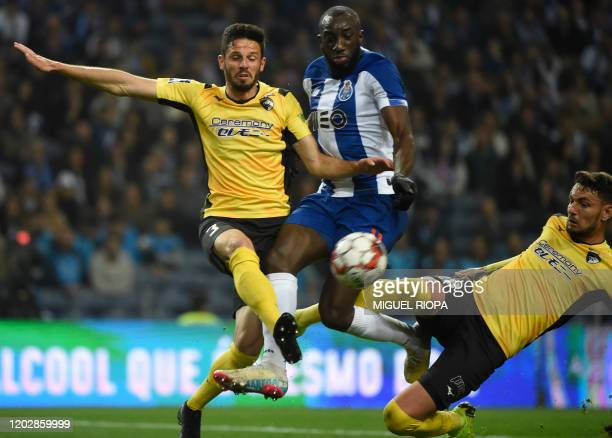 FC Porto's Malian forward Moussa Marega vies with Portimonense's Brazilian defender Lucas Possignolo and Portimonense's Brazilian defender Willyan da...