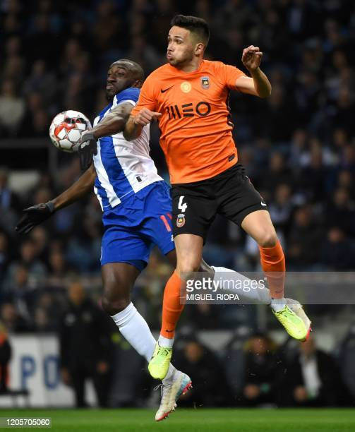 FC Porto's Malian forward Moussa Marega vies with Rio Ave's Portuguese defender Nelson Monte during the Portuguese league football match between FC...