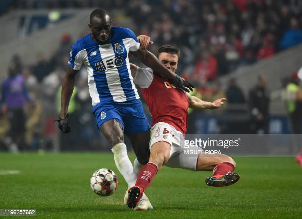 FC Porto's Malian forward Moussa Marega vies with Sporting Braga's Portuguese midfielder Joao Palhinha during the Portuguese Taca da Liga or League...