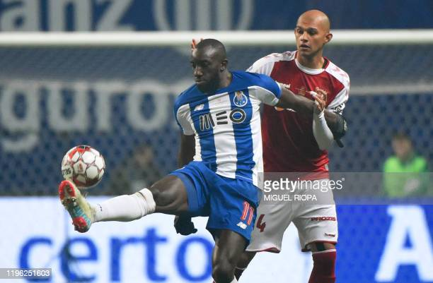FC Porto's Malian forward Moussa Marega vies with Sporting Braga's Brazilian defender Raul Silva during the Portuguese Taca da Liga or League Cup...