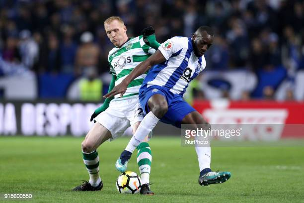 Porto's Malian forward Moussa Marega vies with Sporting's defender Jeremy Mathieu during the Portuguese Cup 2017/18 match between FC Porto and...