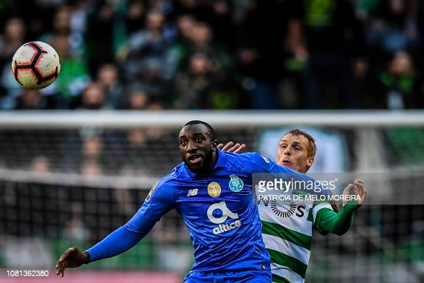 Porto's Malian forward Moussa Marega vies with Sporting's French defender Jeremy Mathieu during the Portuguese League football match between Sporting...
