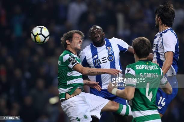 Porto's Malian forward Moussa Marega vies with Sporting's Portuguese defender Fabio Coentrao during the Premier League 2017/18 match between FC Porto...