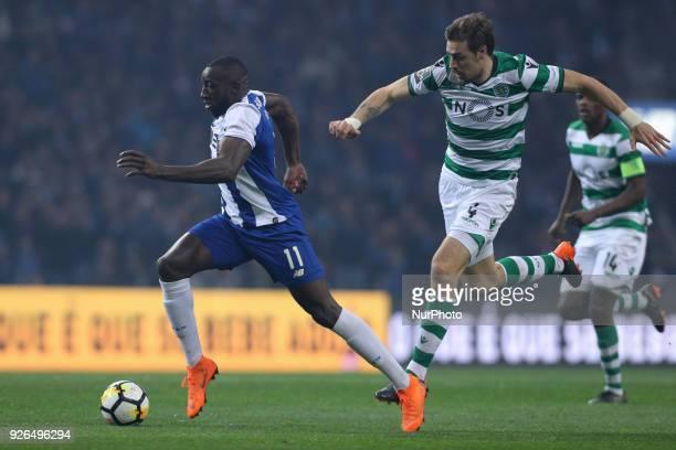 Porto's Malian forward Moussa Marega vies with Sporting's Uruguayan defender Sebastian Coates during the Premier League 2017/18 match between FC...