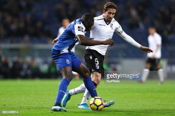Porto's Malian forward Moussa Marega vies with Vitoria SC's Brazilian midfielder Rafael Miranda during the Premier League 2017/18 match between FC...