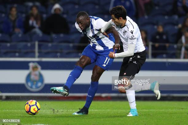 Porto's Malian forward Moussa Marega vies with Vitoria SC's Portuguese defender Marcos Valente during the Premier League 2017/18 match between FC...