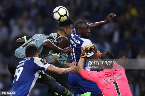 Porto's Malian forward Moussa Marega vies with Vitoria Setubal's Portuguese forward Edinho and Vitoria Setubal's Portuguese goalkeeper Cristiano...