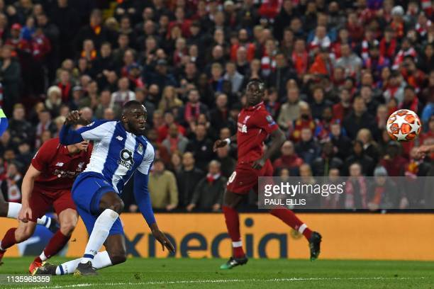 Porto's Malian striker Moussa Marega has this shot saved during the UEFA Champions League quarterfinal first leg football match between Liverpool and...