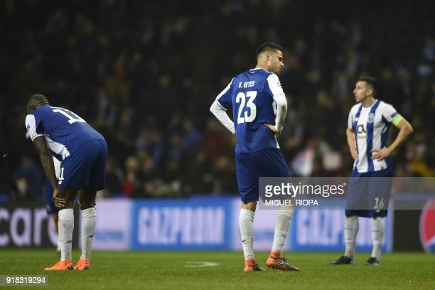 Porto's Malian striker Moussa Marega Porto's Mexican defender Diego Reyes and Porto's Mexican midfielder Hector Herrera react to their defeat on the...
