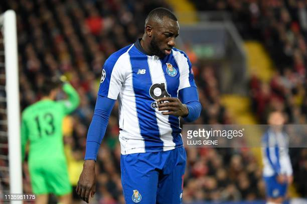 Porto's Malian striker Moussa Marega reacts after missing to score a goal during the UEFA Champions League quarterfinal first leg football match...