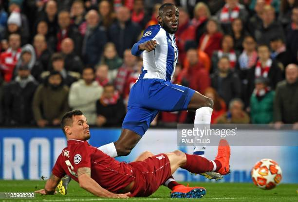 Porto's Malian striker Moussa Marega shoots past Liverpool's Croatian defender Dejan Lovren but has this shot saved during the UEFA Champions League...