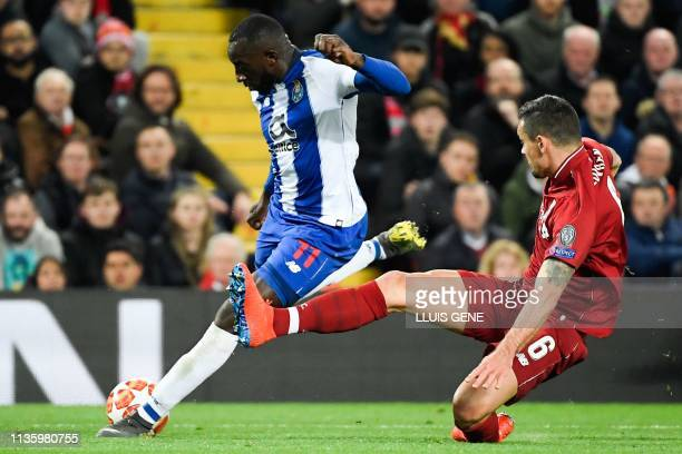 Porto's Malian striker Moussa Marega vies for the ball with Liverpool's Croatian defender Dejan Lovren during the UEFA Champions League quarterfinal...