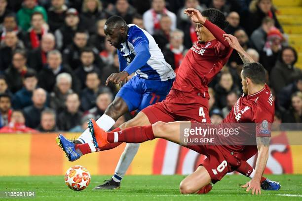 TOPSHOT Porto's Malian striker Moussa Marega vies for the ball with Liverpool's Dutch defender Virgil van Dijk and Liverpool's Croatian defender...
