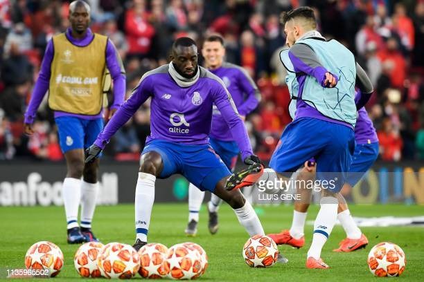 Porto's Malian striker Moussa Marega warms up prior to the UEFA Champions League quarterfinal first leg football match between Liverpool and FC Porto...