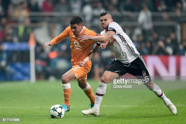 Porto's Maxi Pereira vies for the ball with Besiktas' Pepe during the UEFA Champions League Group G football match between Besiktas JK and FC Porto...