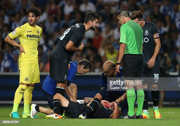 Porto's medical staff look after FC PortoÕs defender from Uruguay Maxi Pereira injury after tackle by Villarreal's midfielder Soriano during the...