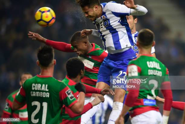 Porto's Mexican defender Diego Reyes heads the ball to score the opening goal during the Portuguese league football match FC Porto vs Maritimo at the...