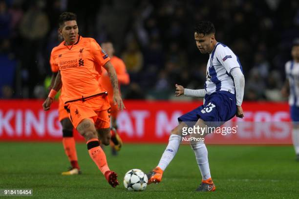 Porto's Mexican defender Diego Reyes in action with Roberto Firmino forward of Liverpool during the UEFA Champions League match between FC Porto and...