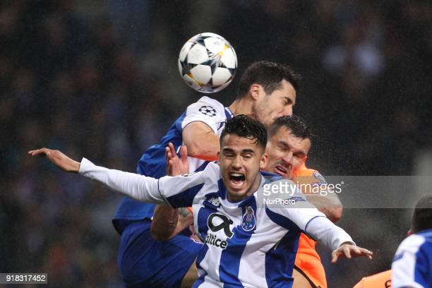 Porto's Mexican defender Diego Reyes vies with Porto's Spanish defender Ivan Marcano and Dejan Lovren defender of Liverpool during the UEFA Champions...