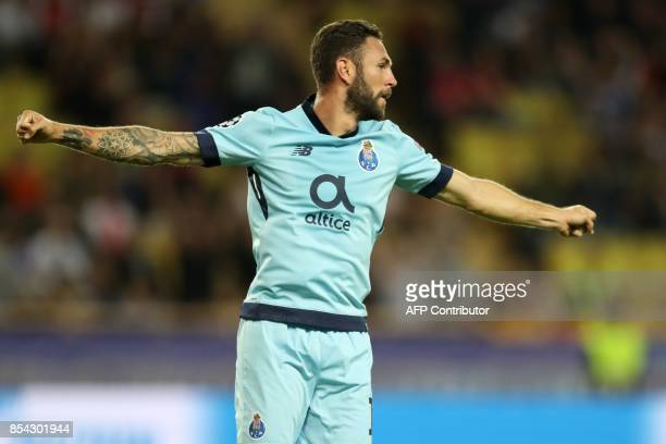 Porto's Mexican defender Miguel Layun celebrates after scoring a goal during the UEFA Champions League Group G football match AS Monaco FC vs FC...