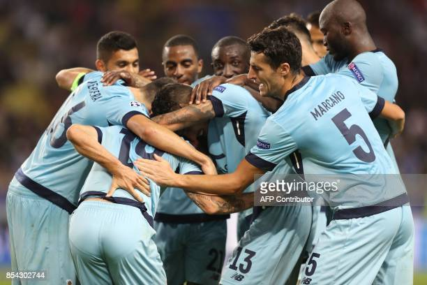 Porto's Mexican defender Miguel Layun celebrates after scoring a goal with his teammates during the UEFA Champions League Group G football match AS...