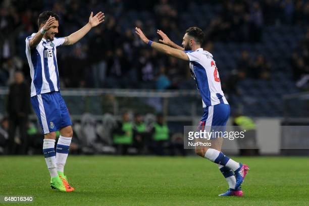 Porto's Mexican defender Miguel Layun celebrates after scoring goal with teammate Porto's Brazilian defender Alex Telles during the Premier League...