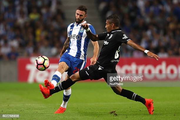 Porto's Mexican defender Miguel Layun in action with Vitoria SC's Brazilian forward Raphinha during the Premier League 2016/17 match between FC Porto...