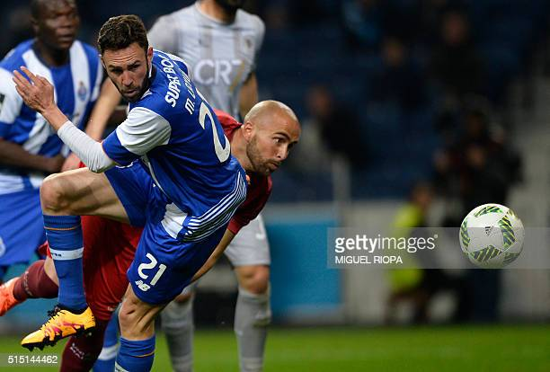 Porto's Mexican defender Miguel Layun misses an attempt on goal beside Uniao Madeira's Mozambican goalkeeper Ricardo Campos during the Portuguese...