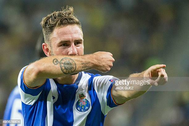 Porto's Mexican defender Miguel Layun reacts after scoring during the UEFA Champions League group G football match between Maccabi Tel Aviv and FC...