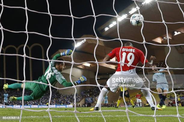Porto's Mexican defender Miguel Layun scores a goal during the UEFA Champions League Group G football match AS Monaco FC vs FC Porto on September 26,...