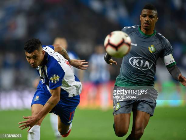 Porto's Mexican forward Jesus Corona and Vitoria FC's Portuguese defender Vasco Fernandes eye the ball during the Portuguese League football match...