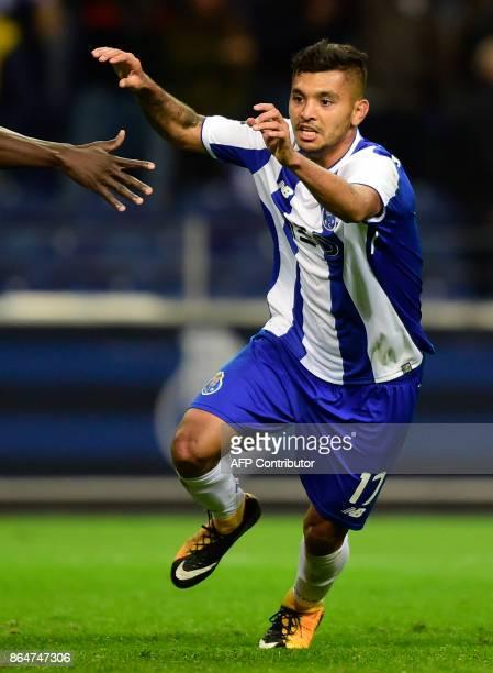 Porto's Mexican forward Jesus Corona celebrates after scoring a goal during the Portuguese league football match FC Porto vs FC Pacos de Ferreira at...