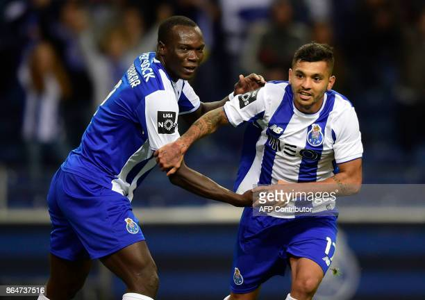 Porto's Mexican forward Jesus Corona celebrates with Cameroonian forward Vincent Aboubakar after scoring a goal during the Portuguese league football...