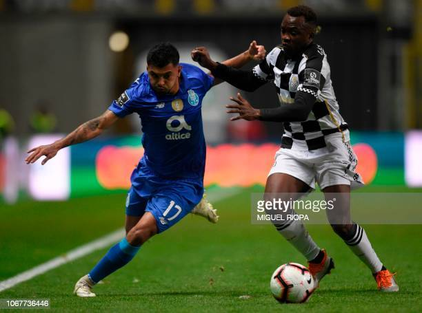 Porto's Mexican forward Jesus Corona challenges Boavista's Angolan forward Mateus during the Portuguese league football match between Boavista FC and...
