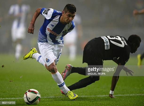 Porto's Mexican forward Jesus Corona controls the ball next to Academica Coimbra's Ghanaian defender Richard Ofori during the Portuguese league...