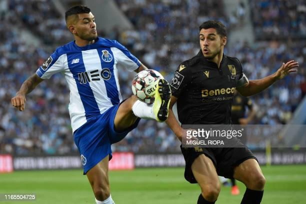 FC Porto's Mexican forward Jesus Corona controls the ball next to Vitoria Guimaraes' Portuguese defender Rafa during the Portuguese League football...