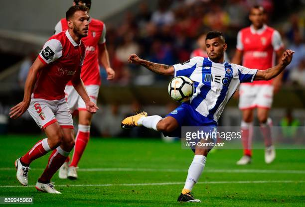 TOPSHOT Porto's Mexican forward Jesus Corona kicks the ball to score the opener next to Sporting Braga's defender Nuno Sequeira during the Portuguese...