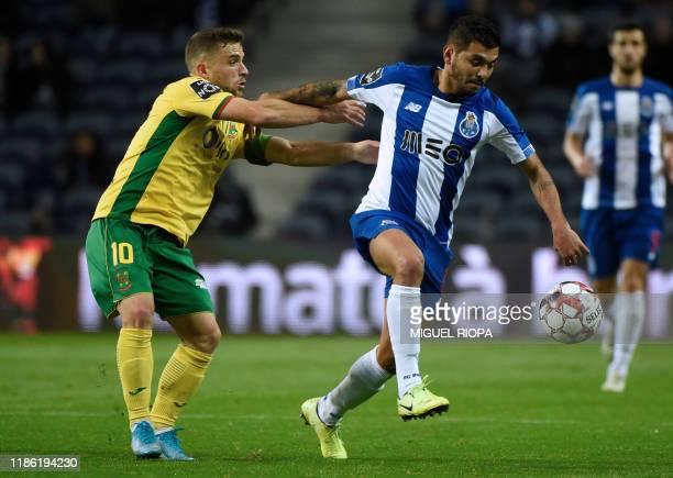 Porto's Mexican forward Jesus Corona 'Tecatito' challenges Pacos Ferreira's Portuguese midfielder Pedrinho during the Portuguese league football...
